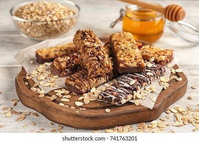 Composition with healthy cereal bars on wooden background