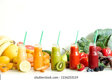 Composition of healthy colorful vegetable juices and smoothies with chia and flax seeds in glass bottles, set vegetables and fruits on the white background, copy space