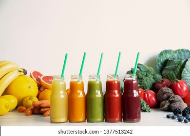 Composition of healthy detox juices and smoothies with seeds. Healthy vegetables and fruits on the white background, copy space. Lifestyle, balance, diet.