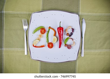A composition of healthy food fruit and vegetables on a plate which make a 2018 number.