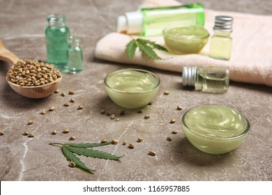 Composition with hemp lotion on grey table