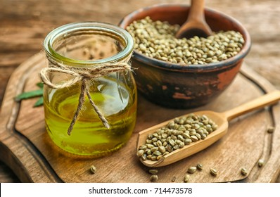 Composition with hemp oil and seeds on wooden table