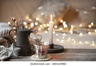 Composition with home decor details on a wooden table. The concept of a cozy home atmosphere. - Shutterstock ID 1855169083