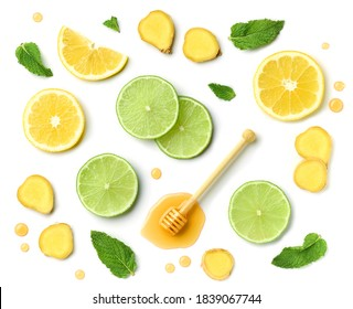 composition of honey spoon, ginger and citrus fruit slices isolated on white background, top view