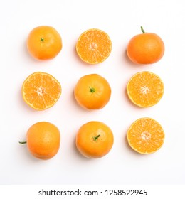Composition with juicy tangerines on white background, top view