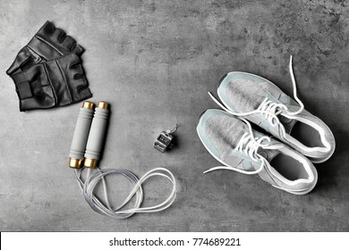 Composition with jumping rope on grey background