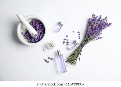 Composition with lavender flowers and natural cosmetic on white background, top view