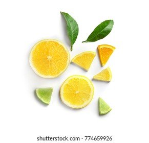 Composition with lemon, lime and orange slices on white background