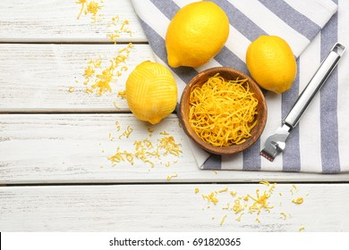 Composition with lemons, zest and special tool on table