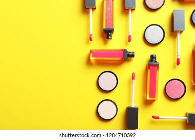 Composition with lipsticks on color background, flat lay. Space for text