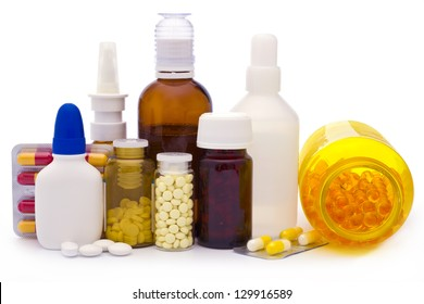 Composition of medicine bottles and pills isolated on white