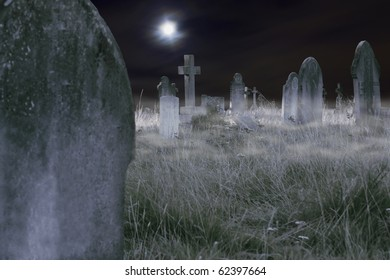 Composition of a moonlit cemetery with fog, old slabs and crosses. Ideal for Halloween!