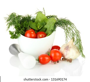 Composition of mortar, tomatoes and green herbals, isolated on white