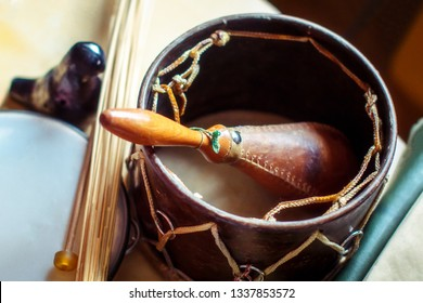 The composition of musical instruments-maracas, Ocarina, tambourine and ethnic drum. Percussion and wind instruments are on the table.