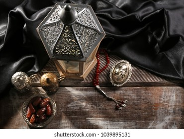 Composition with muslim lamp Fanous on wooden table