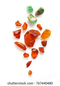 Composition of natural stones of amber and chrysoprase. Amber stone isolated on white background. Natural raw amber. Jewelery from amber.