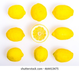 Composition with nine Lemons, one of them cut in half,  photo  Flat Lay Style and Square cut.isolated on white background