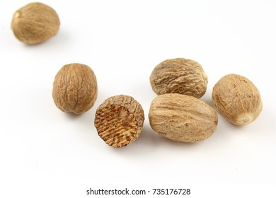composition of nutmeg seeds isolated on a white background