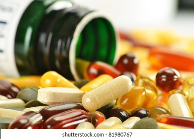 Composition with nutritional supplement capsules and containers. Variety of drug pills