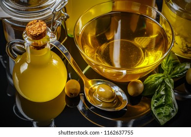 Composition of olive oil and green olives on clipping path background