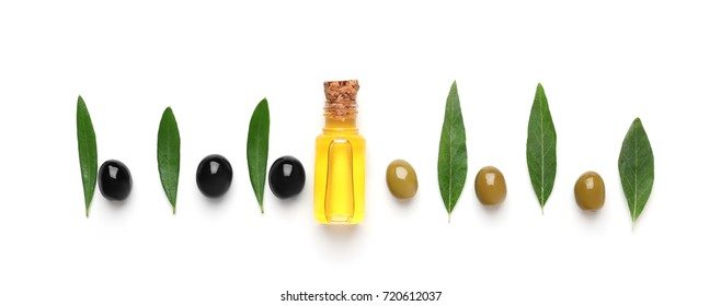 Composition with olive oil on white background