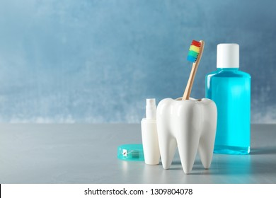 Composition with oral care items on table against color background, space for text. Healthy teeth