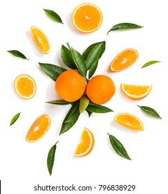 Composition of orange fruits and green leaves isolated on white background, top view.