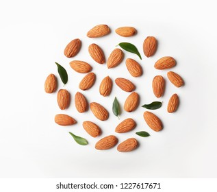 Composition with organic almond nuts on white background, top view