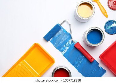 Composition with paint cans and space for text on white background