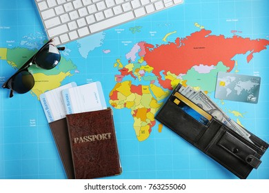 Composition with passports, arrival cards and wallet on world map