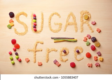 Composition with phrase SUGAR FREE on wooden background