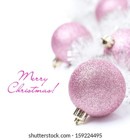 composition with pink Christmas balls and tinsel, isolated on white