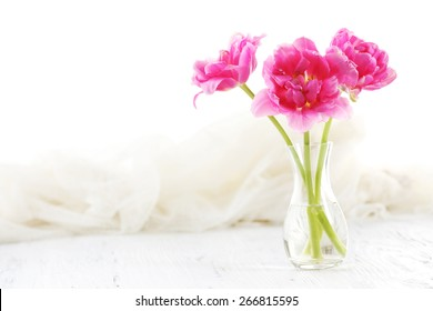 Composition with pink tulips on wooden table, closeup