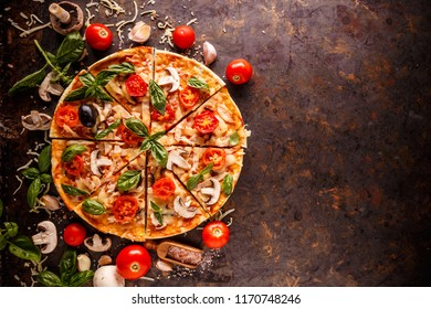 Composition with pizza, cherry tomatoes, mushroom and fresh basil, space for your text