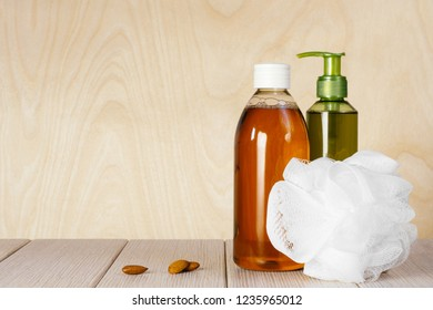 Composition with plastic bottles and washcloth for body care and beauty products