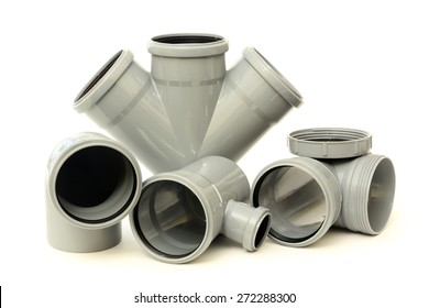 Composition from plastic sewer pipes, isolated on the white