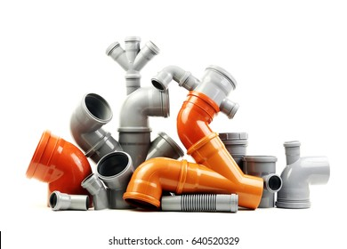 Composition from plastic sewer pipes, isolated on a white