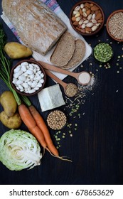 Composition of products containing thiamine, aneurin, vitamin B1 - whole grain bread, cereals, vegetables, legumes, soy, potatoes, molded cheese, nuts, yeast. Healthy food. Top view. Flat lay.