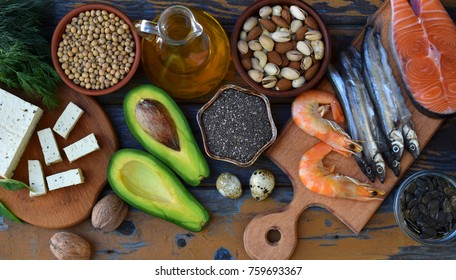 Composition of products containing unsaturated fatty acids Omega 3 - fish, nuts, tofu, avocado, eggs, soybeans, pumpkin seeds, chia, hemp, dill, vegetable oil. Top view. Healthy food