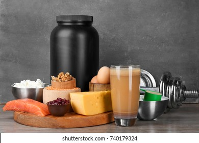 Composition with protein shake, powder and food on table