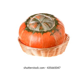 Composition of a pumpkin at the basket. Isolated on the white background.