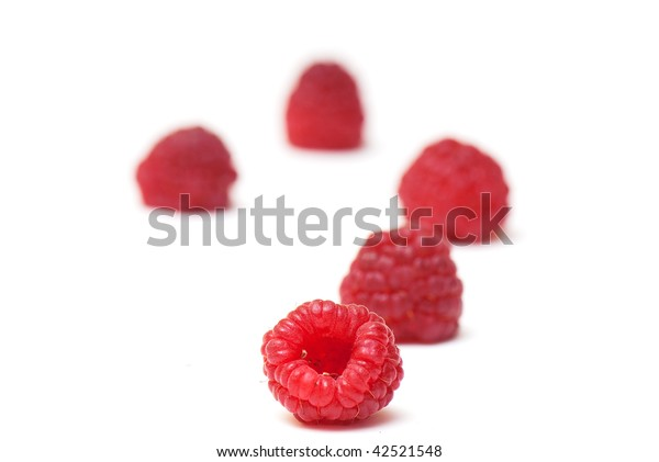composition from a raspberry on the white isolated background