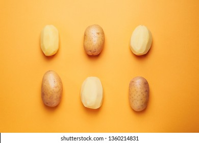 Composition with raw potato on color background