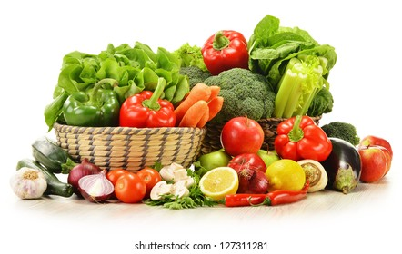 Composition with raw vegetables in wicker basket isolated on white