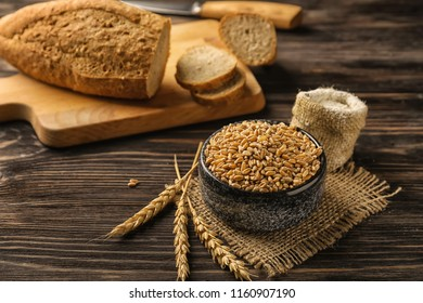Composition with raw wheat on wooden table