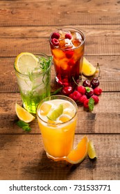 Composition of refreshing drinks on a wooden board