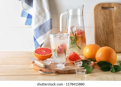 Composition with refreshing grapefruit lemonade on wooden table