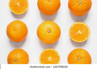 Composition with ripe oranges on white background, top view