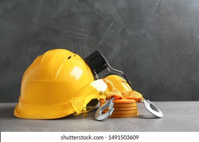 Composition with safety equipment on table against grey background. Space for text