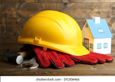 Seguridad en el trabajo images stock photos vectors shutterstock composition with safety helmet leather gloves tools and decorative house on wooden background malvernweather Images